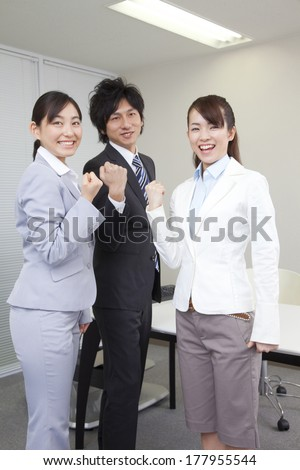 2 Businesswomen and businessman looking motivated