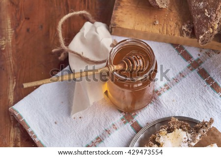 butter and honey on a countryside breakfast - top view