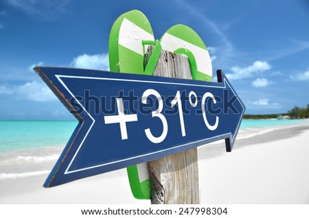 +31C arrow on the beach - stock photo