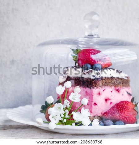Cake in a glass bell jar
