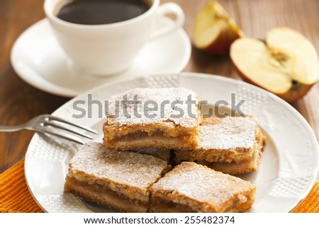 cakes with apples and coffee for the breakfast - stock photo