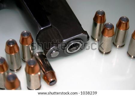 40 cal semi auto pistol and ammo - stock photo