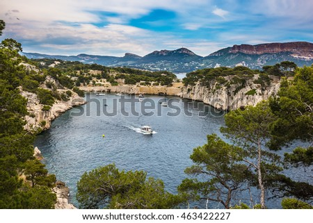 Calanques on the Mediterranean coast. The fjords between stony coast. White sailing yacht sailing on the lagoon