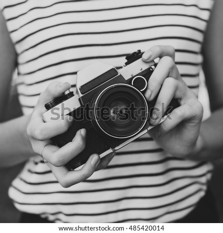 camera in the hands of the girl (black and white photo)