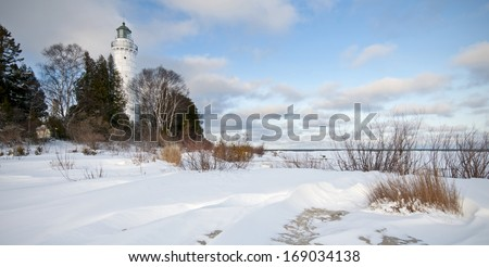 """Cana Island Winter""  Winter at the Cana Island Lighthouse in Door County, Wisconsin. - stock photo"