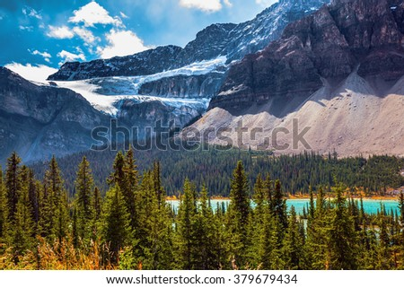 Canada, Rocky Mountains, Banff National Park. The Glacier Crowfoot over Bow River in bright striped mountains - stock photo