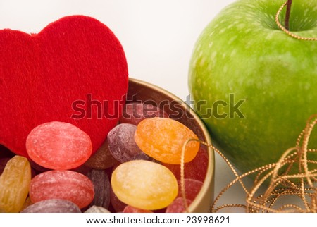 candies in a jar, heart, apple