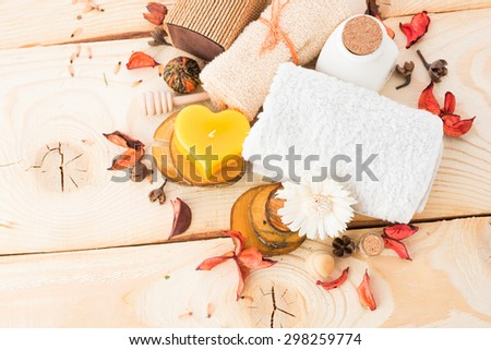 candle, cinnamon with towel on wood - stock photo