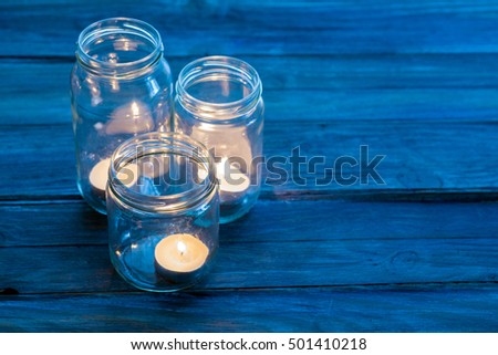 candles in the darkness of a room