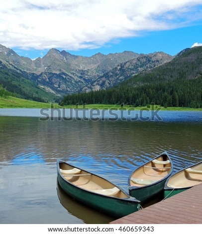 canoes in the summer at piney lake, near vail, colorado