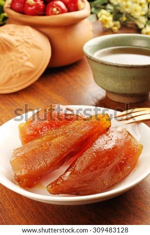 Caramelized sweet potato on the white plate  - stock photo