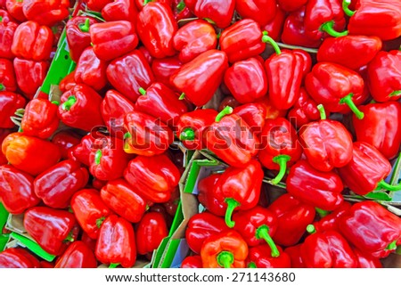 Cardboard boxes with red bell pepper in a supermarket                              - stock photo