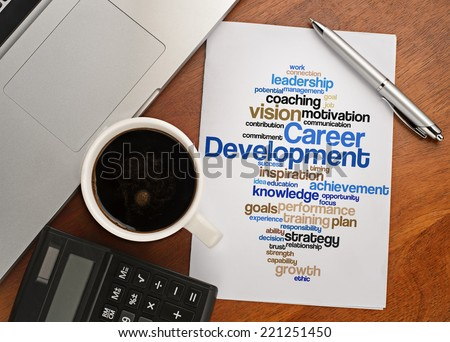 """""""CAREER DEVELOPMENT word cloud arrangement"""" Notebook with text vision on table with coffee, calculator and notebook  - stock photo"""