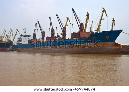 Cargo ships in a port of Hai Phong, Vietnam. Hai Phong port is one of the two biggest ports in Vietnam.