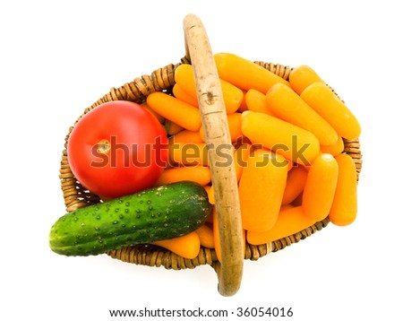 carrot  tomato and cucumber in basket against the white background