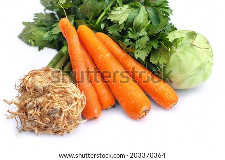 Carrots, celery and kohlrabi, raw on white background - stock photo