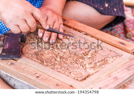 Carving wood - carpenter - stock photo