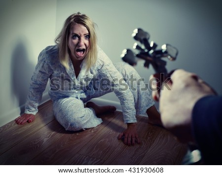 Casting out a demon from a woman through prayer. Exorcisms over deranged and crazy person. - stock photo