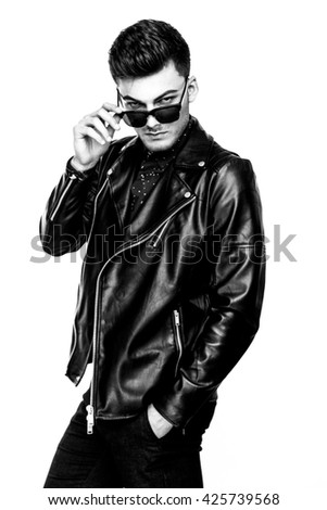 Casual handsome attractive man hipster guy wearing leather jacket  on white background black and white photo