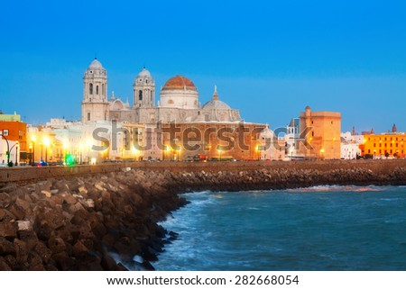 Cathedral and  embankment in evening. Cadiz, Spain  - stock photo