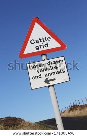 'Cattle Grid' ahead warning road sign.