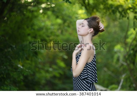 Caucasian girl relaxing and enjoying life in forest's fresh air - stock photo