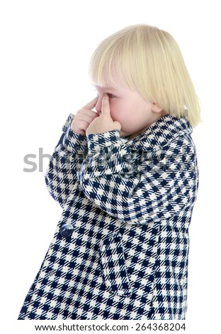 Caucasian little girl wipes her tears fingers.  - isolated on white background - stock photo