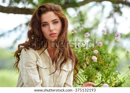 Caucasian  woman smiling happy on sunny summer or spring day outside in park.