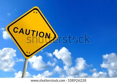 caution traffic sign on bluesky - stock photo