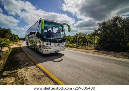 - Cayo Santa Maria, Cuba. February 18th 2015. Shuttle bus that Tourists can use for tree convertible pesos if they want to travel between the different resort on the island. - stock photo