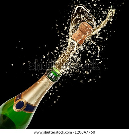 Celebration theme with splashing champagne, isolated on black background - stock photo