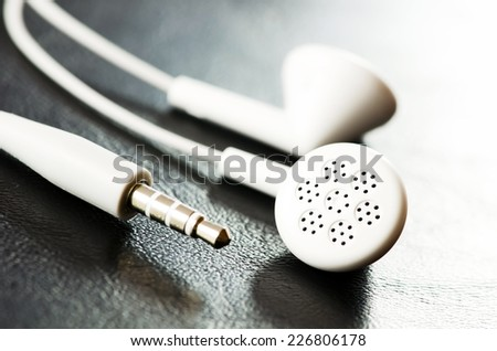 Cell phone headset on black background. - stock photo