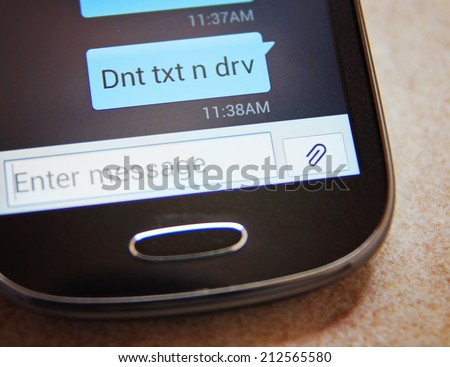Cell phone message Don't Text & Drive close up  - stock photo
