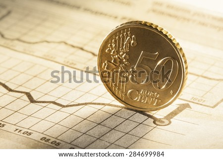 50 cent on newspaper chart - stock photo