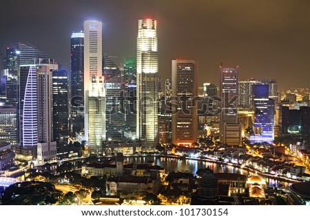 Central Business District in Singapore City at night. - stock photo