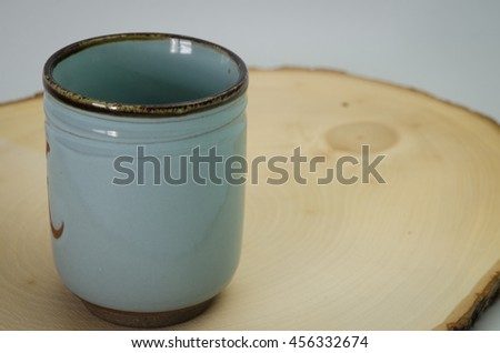 ceramic tumbler on wood board,traditional japanese style ceramic glass.