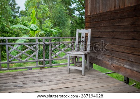 chair and floor of old Thai house - stock photo