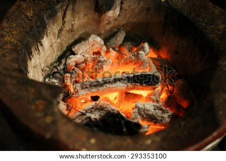 charcoal with flames for cooking - stock photo