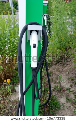 Charge point electric vehicle - stock photo