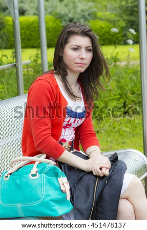 Charming young brunette lounging outdoors in summer