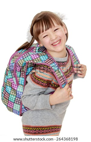 Cheerful girl with a backpack on his back - isolated on white background - stock photo