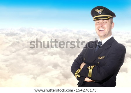 Cheerful pilot on a background of clouds