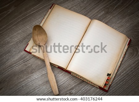 chef recipe recipe book with wooden ladle