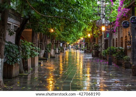 CHENGDU, SICHUAN/CHINA-MAY 13: Kuanzhai Alleys scenery-Early morning after the rain  on May 13, 2016 in Chengdu, Sichuan, China. They are one of old alleys in Chengdu, Sichuan, China.  - stock photo