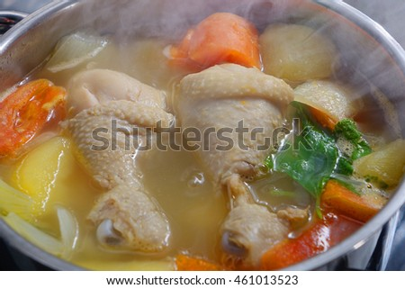 Chicken soup in the pot