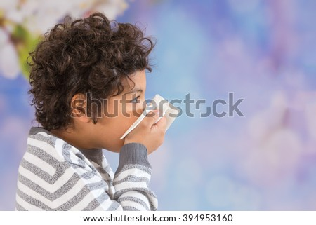 child with curly hair suffering from the flu.  - stock photo