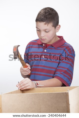 Child with hammer on white background