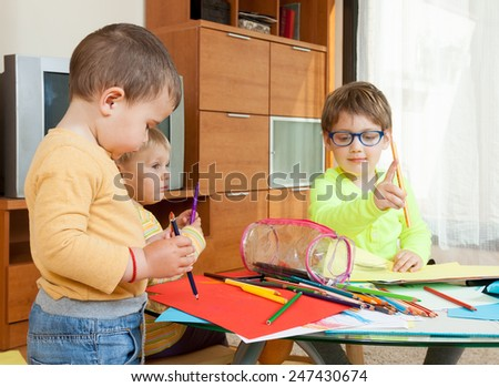 children drawing with crayons at  table. - stock photo