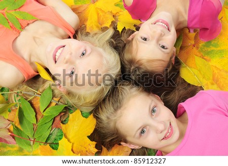 Children in autumn leaves - stock photo