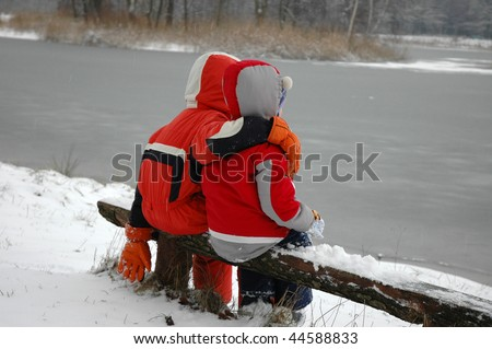 children on the bench in winter time